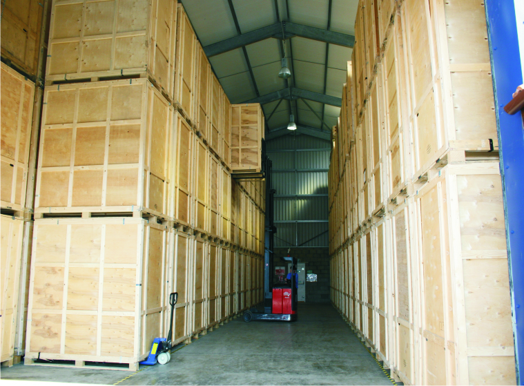 Wooden storage containers and forklift in warehouse